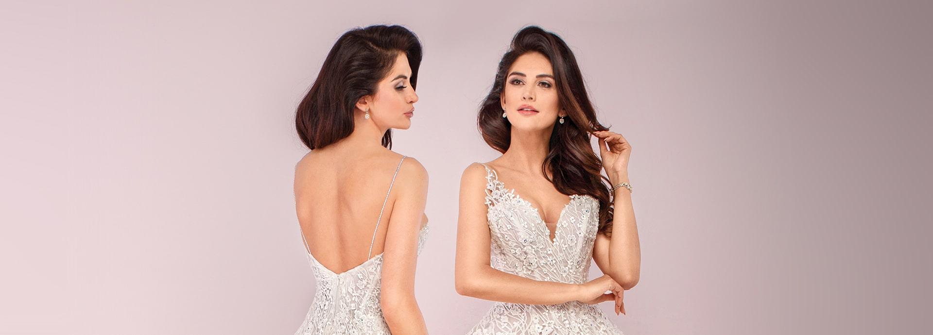 Koronkowy top sukni ślubnej i odkryte plecy z cieniutkimi ramiączkami